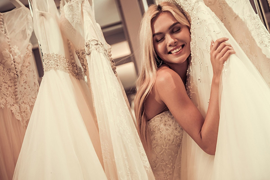 A-bride-to-be-chooses-her-perfect-wedding-gown-329345